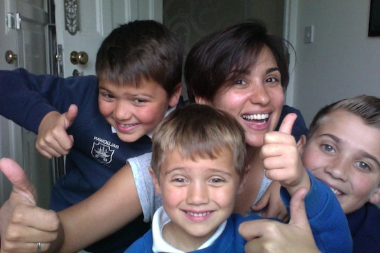 Happy mum and school-age children because their online private tutor helped them achieve results in maths, science, english, GCSEs and A-level exams